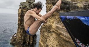 Cyrille Oumedjkane of France dives from the 28-metre platform during the Red Bull Cliff Diving World Series in the Azores