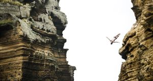 Steven LoBue of the US dives from the 27.5 metre rock during the third stop of the Red Bull Cliff Diving World Series
