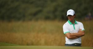 Rory McIlroy looks on during the first round of the British Open. Photograph:  Matthew Lewis/Getty Images