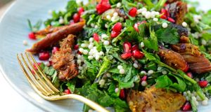 Crispy lamb and giant cous cous salad