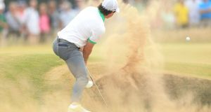 Rory McIlroy will have to dust himself off and look to salvage some pride in tomorrow's second round of the   2013 Open Championship at Muirfield Golf Club, East Lothian.  Photograph: Mike Egerton/PA Wire