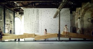 Heneghan Peng's giant wooden see-saw bench