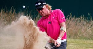 Miguel Angel Jimenez of Spain hits out of a bunker on the 18th  during the first round of the 142nd Open Championship at Muirfield. (Photograph:  Rob Carr/Getty Images