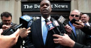 Detroit's emergency financial manager Kevyn Orr talks to  media outside the Detroit Newspapers building. The city of Detroit's municipal bankruptcy, the largest in US history puts at risk the future of retiree pension and health benefits for thousands of city workers. Photograph:  Rebecca Cook/Reuters