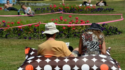 Lunchtime sun seekers at Merrion Square in Dublin during the Street World Performance championships. Photograph: Cyril Byrne/The Irish Times