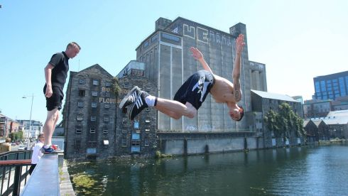 The lads jump into Grand Canal Dock in Dublin city centre. Photograph: Niall Carson/PA Wire