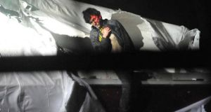 Boston bomb suspect Dzhokhar Tsarnaev in one of the dramatic pictures released without permission by Sgt Sean Murphy, a tactical photographer with the Massachusetts state police. He has been suspended from duty as a result.