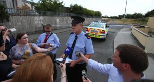 Garda Inspector John Ferris speaks to the media at the scene  today. Photograph: Niall Carson/PA