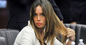 Nicole Minetti, Silvio Berlusconi's former dental hygienist who later became a PDL regional councillor, was sentenced to five years in jail today after she was one of three found guilty of aiding and abetting prostitution. Photograph: Paolo Bona/Reuters