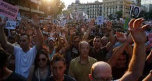 People  protested outside the People's Party (PP) headquarters in Madrid on Thursday demanding Mariano Rajoy resign or at least give explanations. Photograph: Juan Medina/Reuters