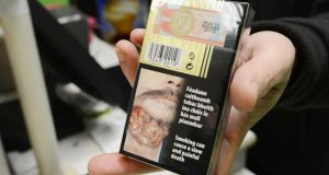 Photographs on cigarette packets now on sale in shops.  Photograph: Alan Betson