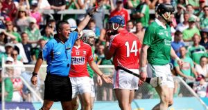 James McGrath red cards Patrick Horgan of Cork at Thurles. Photograph: James Crombie/Inpho
