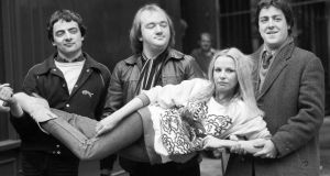 The Not the Nine O'Clock News team in 1980: (from left) Rowan Atkinson, Mel Smith, and Griff Rhys Jones carrying Pamela Stephenson. Photograph: PA Wire