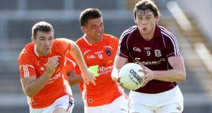 Armagh's Brendan Donaghy and Stephen Harold follow Thomas Flynn of Galway at Pearse Stadium. Photograph: James Crombie/Inpho