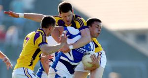 Wexford's Rory Quinlivan tries to stop John O'Loughlin of Laois at Wexford Park. Photograph: Ryan Byrne/Inpho