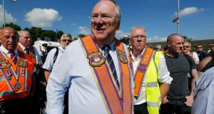 The Rev Mervyn Gibson with Orange marshalls on the Woodvale Road in Belfast on Saturday afternoon. Photograph: Kelvin Boyes/Press Eye