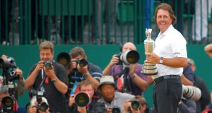 Phil Mickelson  holds the Claret Jug after winning the British Open  at Muirfield yesterday. Photograph: Brian Snyder/Reuters.