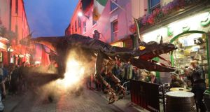 An angry dragon roaming through High Street during Galway Arts Festival. Dragons was presented by one of Europe's most exciting outdoor theatre companies, the world famous Sarruga from Barcelona. Photograph: Joe O'Shaughnessy