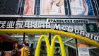 McDonald's, above in Shenzhen, China, is to open its first outlet in Vietnam in 2014, joining companies such as Starbucks which arrived there this year