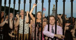 Crowds of people try to look at a notice formally announcing the birth of a son to Britain's Prince William and Catherine, Duchess of Cambridge. Photograph: John Stillwell/Pool/Reuters