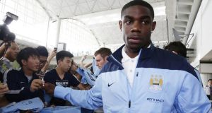 Micah Richards has played down speculation that he could leave Manchester City.  Photograph: Jessica Hromas/Getty Images