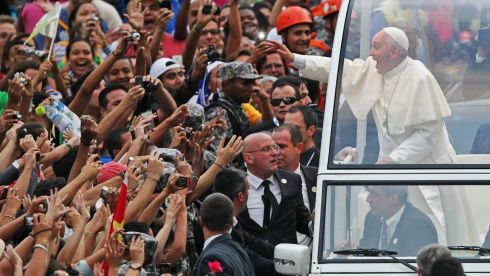 Pope Francis greets the crowd of faithful from his popemobile in downtown Rio de Janeiro. Photograph: Ueslei Marcelino/Reuters