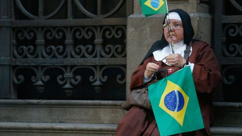 A nun from waits to greet Pope Francis in Rio de Janeiro. Photograph: Stefano Rellandini/Reuters