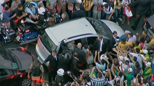 The car carrying Pope Francis is mobbed by wellwishers as it gets stuck in traffic as he is driven from the airport to the Metropolitan Cathedral in downtown Rio de Janeiro.  Photograph: Pool/Reuters
