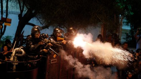 "Riot police officers fire tear gas during a protest against the visit of Pope Francis, near Guanabara palace in Rio de Janeiro July 22, 2013. The protesters said that the Pope's visit would represent a huge cost for the country. Pope Francis will spend a week in Rio de Janeiro to preside over the Catholic Church's 28th World Day of Youth, a gathering sometimes dubbed a ""Catholic Woodstock"" that occurs in a different city every two years. Photograph: Pilar Olivares/Reuters"