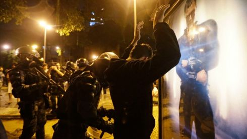 A riot police officer detains a demonstrator during clashes near Guanabara Palace.  Photograph: ReutersS/Ricardo Moraes