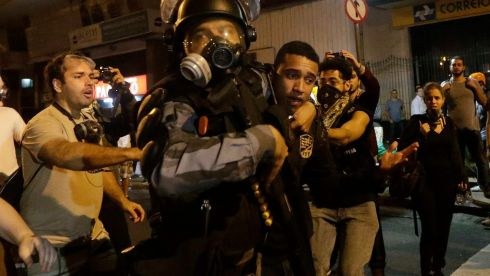 Riot police detain a demonstrator during clashes near Guanabara Palace. Photograph: Ricardo Moraes