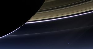In this rare image taken on July 19, 2013, the wide-angle camera on NASA's Cassini spacecraft has captured Saturn's rings and our planet Earth and its moon in the same frame.  The earth is the blue dot at the bottom right of the image. Photograph: NASA/JPL-Caltech/Space Science Institute