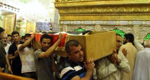Mourners carry the coffin of a victim killed during an attack on a prison in Taji, during a funeral at the Imam Ali shrine in Najaf, 160 km south of Baghdad. Photograph: Reuters