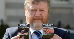 Minister for Health James Reilly has proposed the introduction of standardised or plain packaging of tobacco products. Photograph: Dara Mac Dónaill/The Irish Times