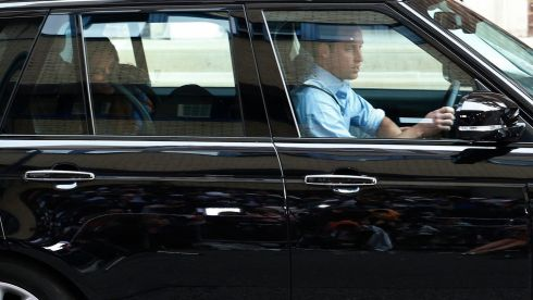 Britain's Prince William, his wife Catherine, Duchess of Cambridge and their baby son drive away from the  Hospital. Photograph: Suzanne Plunkett/Reuters