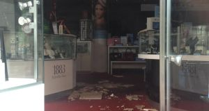 Fallen ceiling tiles inside Clery's ground floor. Photograph: Genevieve Carbery/The Irish Times