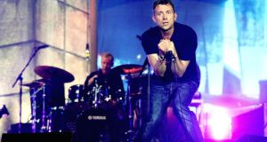 Blurred lines: Damon Albarn of Blur performing at a charity gig in 2012, at the invitation of old Britpop rivals Oasis. Photograph: Ian West/PA