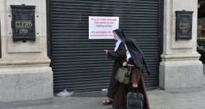 Nuns on  O'Connell Street as  Clery's store remains closed due to water damage. Photograph: Alan Betson / The Irish Times