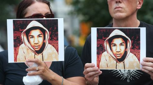 People hold photos of Trayvon Martin at a rally honoring the late youth at Union Square in Manhattan, New York City. Photograph: Mario Tama/Getty Images