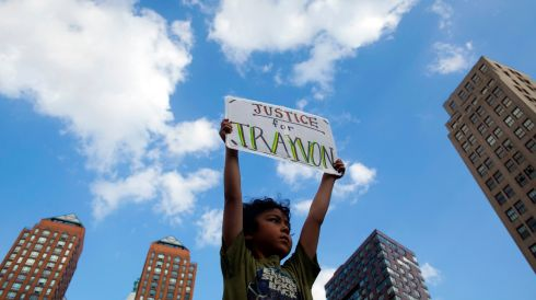 A young boy participates in the New York protest. Photograph: Eric Thayer/Reuters