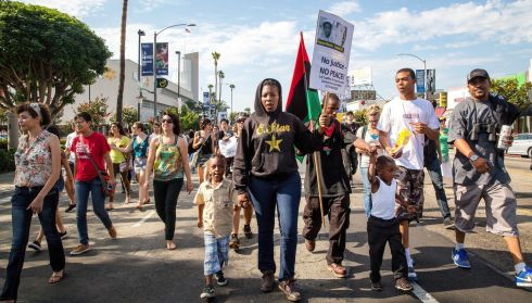 A protest on Crenshaw Boulevard in Los Angeles. Photogrraph: Monica Almeida/New York Times