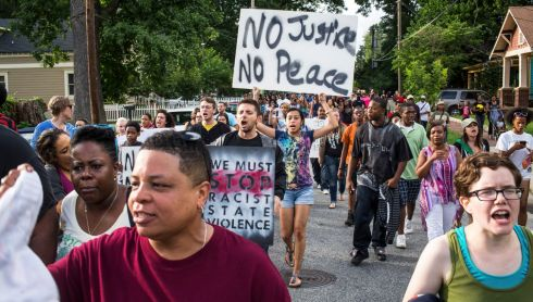 Protesters march on Lawton Street in Atlanta. Photograph: Raymond McCrea Jones/The New York Times