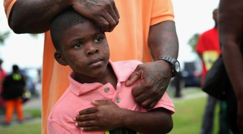 Terrance Smith II (7), stands with his father during a protest at Mellon Park in Sanford, Florida. Photograph: Scott Olson/Getty Images