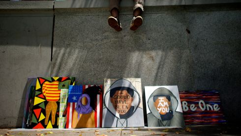 Sean Hassett creates paintings in support of the late Trayvon Martin at Love Park in Philadelphia. Photograph: Mark Makela/New York Times