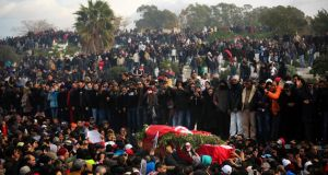 A crowd watches as the coffin of Tunisian opposition politician Chokri Belaid is carried during his funeral in the Jallez cemetery in Tunis in February. Photograph: Tara Todras-Whitehill/The New York Times.