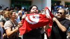 Baklis, the daughter of assassinated Tunisian opposition politician Mohamed Brahmi, holds a Tunisian flag while mourning his death in Tunis today. Photograph: Zoubeir Souissi/Reuters.