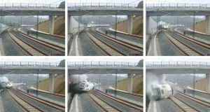 A train derails in this series of still images from the video of a security camera near Santiago de Compostela, northwestern Spain, yesterday. Reuters