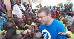 Plan Ireland's deputy regional director for West Africa Damien Queally with children in Mali