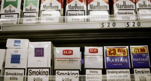 Packets of cigarettes  on display. By 2014 plain packets will be in every shop in the State. Photograph: Getty Images