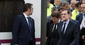 Spanish prime minister Mariano Rajoy (right) arrives at the scene of a train crash that killed at least 77 people on July 25th, 2013 at Angrois near Santiago de Compostela, Spain. Photograph: Reuters